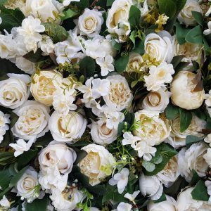 white rose and foliage flower wall